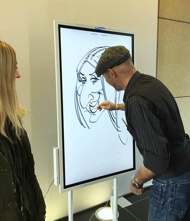 schnellzeichner und karikaturist zeichnet eine karikatur, show auf samsung-event