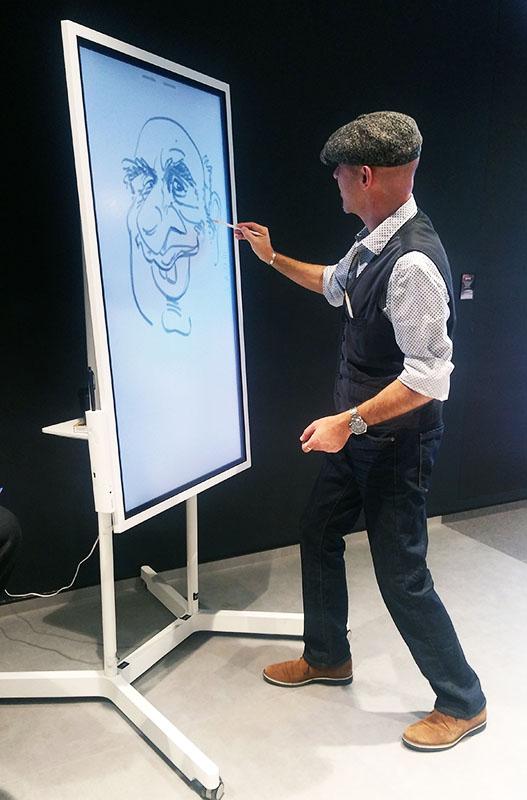 digitaler schnellzeichner für messe, karikaturist am digitalen flipchart, messe-attraktion
